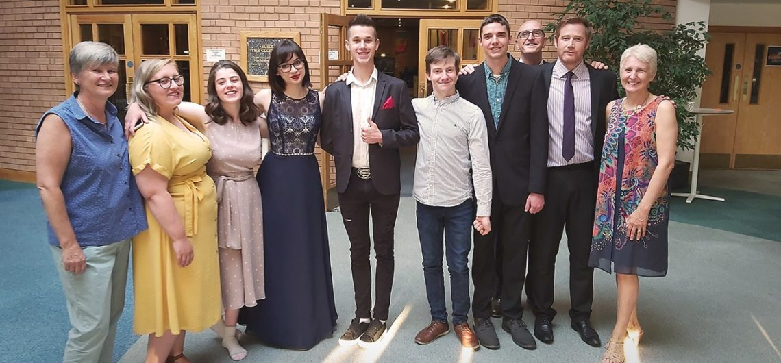 Previous Daniel Challenge team posing with leaders at their graduation.